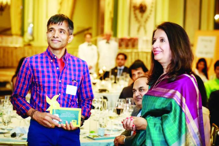 Ambassador Nirupama Rao presents a plaque to Professor Damodaran during the CRY Pledge 2015 Gala Dinner at The Taj Pierre in New York.