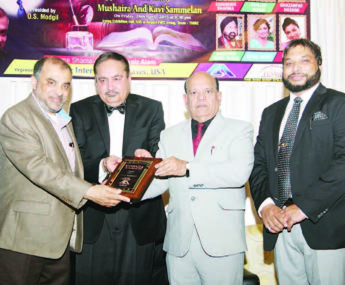 Chief Guest Nasir Mehmood is receiving Unity Award . Others in the picture- President O.S. Modgil, and Noor Amrohvi