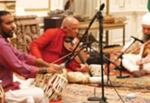 Pt. Dinesh Kumar Prabhakar (center) performs. He is accompanied on Tabla by Avirodh Sharma (left) and on Violin Daljeet Singh Sokhey (right).