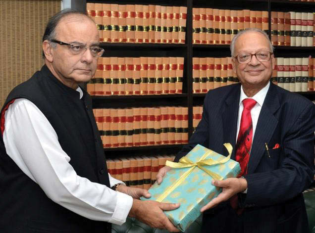 Union Finance Minister Arun Jaitley receives the Seventh Pay Commission Report from the chairman, Ashok Kumar Mathur, in New Delhi.