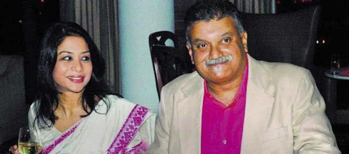 In happier times. Indrani (left) and Peter Mukerjea.
