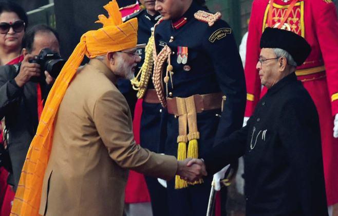 Prime Minister Narendra Modi greets President Pranab Mukherjee at the 67th Republic Day celebrations in New Delhi.