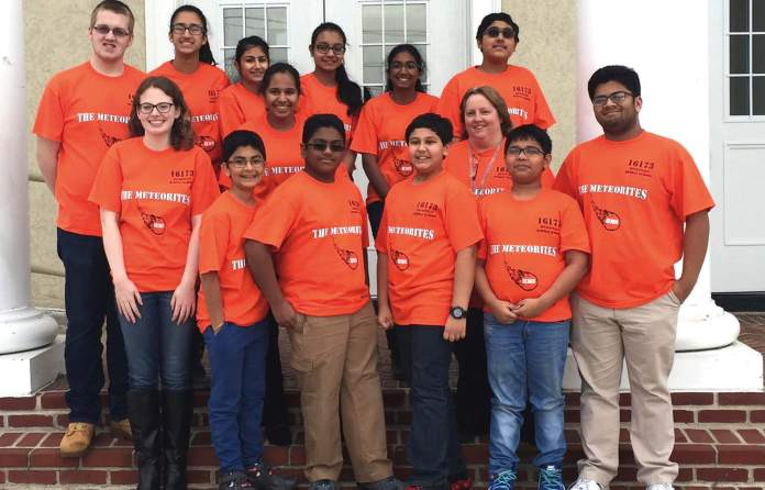A rookie team, Hicksville Middle School's Meteorites has reached the FIRST LEGO Robotics Competition. Their mentor Shiv Chopra (front row, extreme right) is President of Hicksville High School's robotics program.