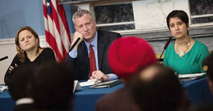 Speaker Melissa Mark-Viverito, Mayor de Blasio and Commissioner for Immigrant Affairs Nisha Agarwal listen to the suggestion of The Indian Panorama editor Prof. Saluja at the Ethnic Media Roundtable at City Hall on February 17. Photo/ William Alatriste for the City Council