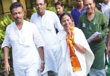 TMC chief Mamata Banerjee was sworn in as Chief Minister of West Bengal on Friday, May 27. Here she is seen with her party men during election campaign ~ File photo