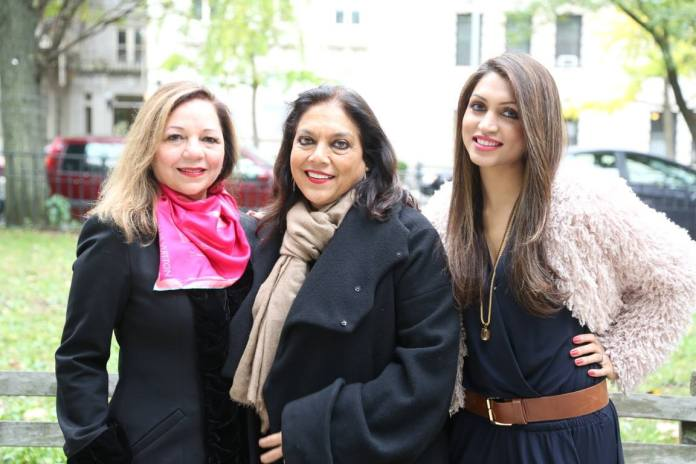 Dr Rashmee Sharma (left) and Co-owner of Roshni Media Group Mani Kamboj pose with Mira Nair