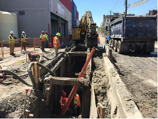 Crew install new sewers on West 21st Street in Coney Island.