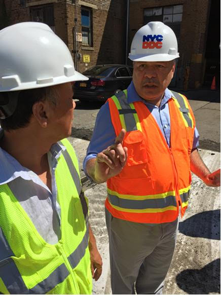 DDC Engineer-in-Charge Jatin Upadhyay, a 28-year veteran of City construction projects, talks to a crew member.