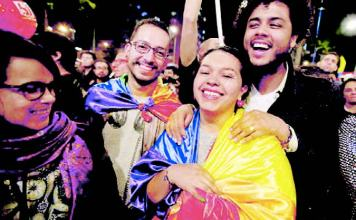 Joyous moment: People celebrate after the peace deal in Bogota on Wednesday, August 24.