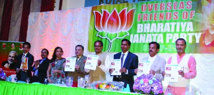 Madhya Pradesh Chief Minister Shivraj Singh Chouhan (fourth from right) releases monthly newsletter of OFBJP in Edison, NJ Photo / Courtesy Chandrakant Trivedi