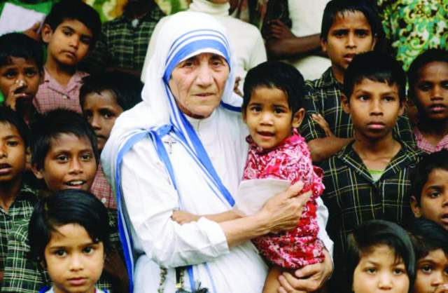 """Mother Teresa with orphans in Kolkata. She will become """"St. Teresa of Calcutta"""" in a Sept. 4 canonization ceremony led by Pope Francis"""