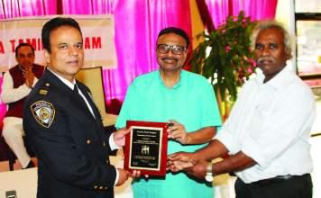Prakash M Swamy, president and John Joseph, Chairman of the Sangam present the award to Capt. Stanley George