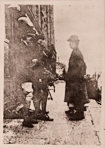 The original image of the surrender. Pearse in the broad brimmed hat, Elizabeth O'Farrell,s feet next to him.