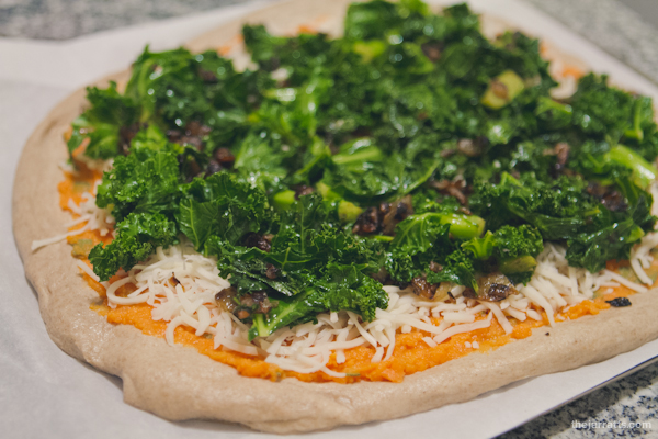 Top with cheese, kale and onions