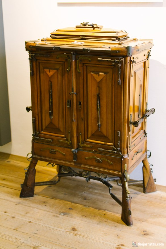 A cabinet made from rifle pieces, part of the military history display