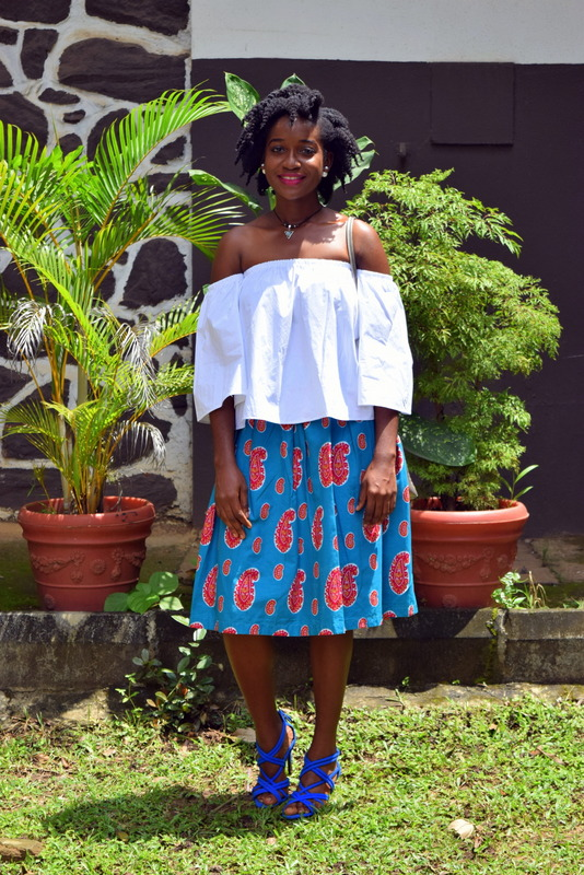 One way to style an off shoulder top with a midi skirt