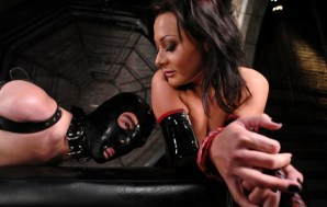BDSM submissive gets flogged and whipped.