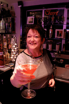 Tammy with a cocktail at her home bar.