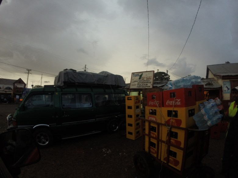 An image at the taxi-brousse station. There are usually dozens of these vehicles packed and loaded, just waiting to fill up before they head to their destination.