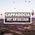 Dozens of hot air balloon over the landscape of Cappadocia, Turkey.