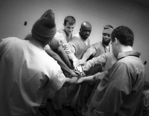 Ensemble member Marquise Carter passes energy around the circle in a theater exercise.