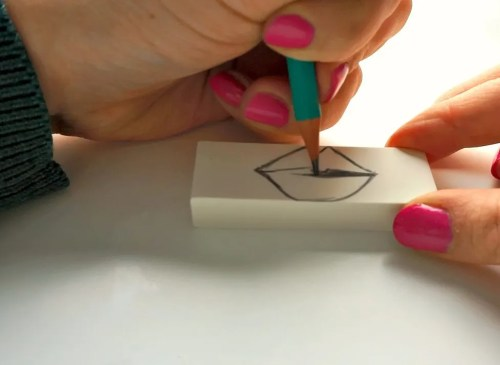 How to make an easy stencil out of an eraser. DIY Lip Shirt tutorial by The Makeup Dummy
