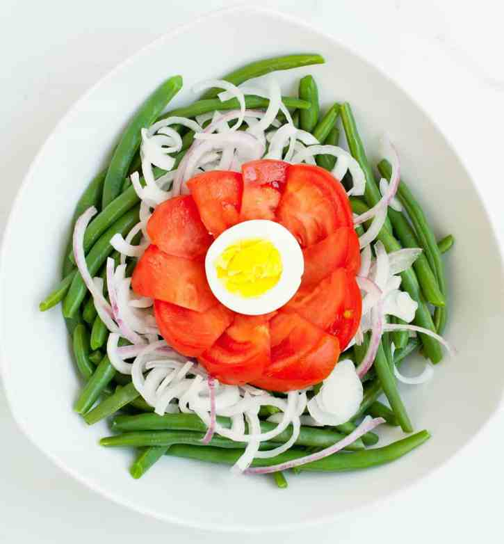 Garden Green Bean Salad. An easy and delicious salad made with garden fresh veggies and a simple, made in the bowl, vinaigrette. Delicious served warm, room temperature or cold!