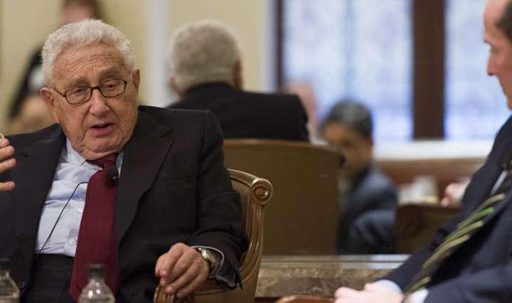 Henry Kissinger and John Wolf