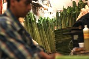 Banana stalks, trimmed of their leaves, bunched together at Mercado Merced