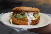 A pelona, or fried sandwich stuffed with lettuce, crema and shredded meat