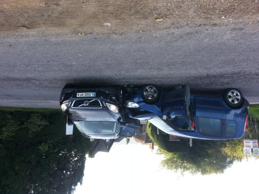a car crash, with a blue Skoda Roomster hitting the side of a black volvo 4x4