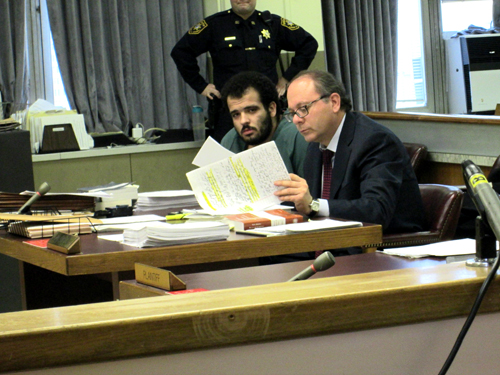 Photos by Ron LeirCarlos Campos confers with his attorney Joseph Russo.