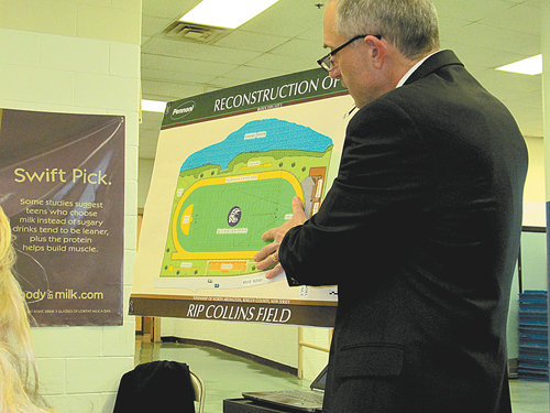 Photo by Ron Leir Schools Superintendent Oliver Stringham displays rendering of proposed improvements to Rip Collins Field