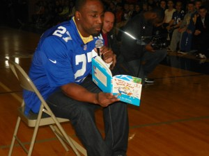 "Photo by Jim Hague New York Giants safety Stevie Brown reads ""I Wish I Had Duck Feet"" to Lyndhurst third and fourth graders as part of ""Read Across America"" Friday."