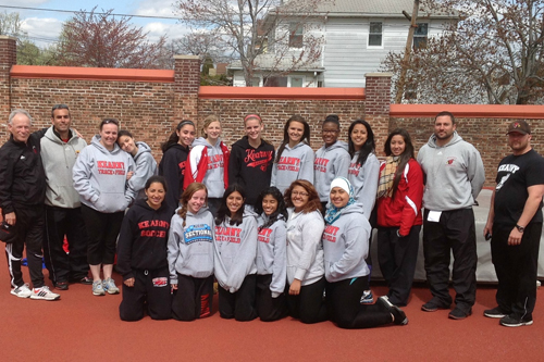 Members of the Kearny girls' track and field team that won the Hudson County Interscholastic Athletic League Relay Championships get together on the track at the high school. Front row, from l., are Amber Crispin, Aislinn Sroczynski, Erika Alzamora, Bianca Torales, Maria Angulo and Omayma Saadani. Back row, from l., are assistant coach Jim Cifelli, assistant coach Vin Almeida, Mandie Lavelle, Wendy Carranza, Chelsea DaSilva, Mariah Davilla, Haley Durning, Anna Czykier, Justine Curtis, Noemi Campos, Lissette Villata, head coach Al Perez and assistant coach John Kryzanowski.