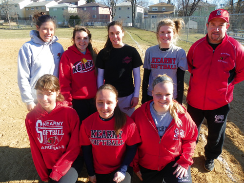 Photo by Jim Hague The Kearny High School softball team looks to be competitive once again this season. Front row, from l., are Kristen Stankus, Nicole Stankus and Jennifer Stankus. Back row, from l., are assistant coach Amy Goldman, Emily Papa, Kelsey French, Kerry Sweeney and head coach Jim Pickel.