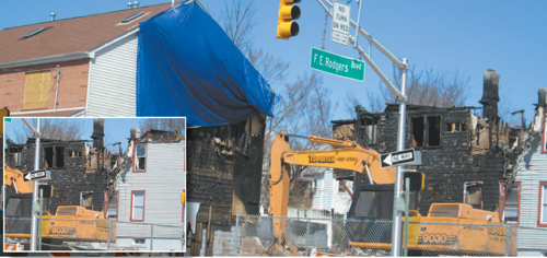 Photos by Ron Leir Demolition crew at work Monday finishing off cleanup at Rodgers Boulevard fire scene.