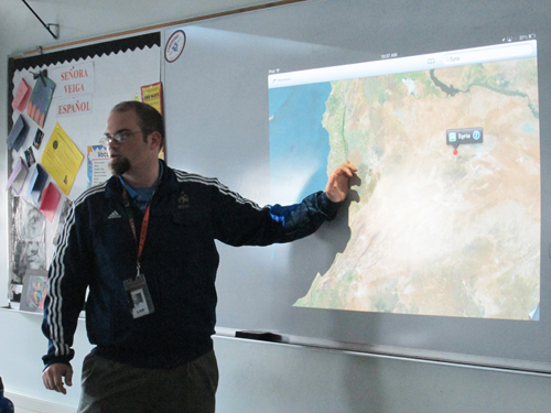 Photo by Ron Leir World History Honors teacher Patrick Newman projects a digital map image to review with his students.