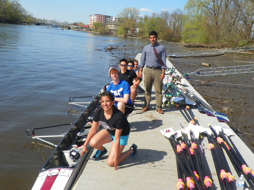 Photo by Jim Hague The North Arlington novice 4 boys' team, with coxswain Daniela Camacho, Vinny Ribeiro, Bryan Ugaz, Nathaniel DeLeon and Jose Antunes and head coach Fabian Cortez (standing) head to the river for a recent workout.