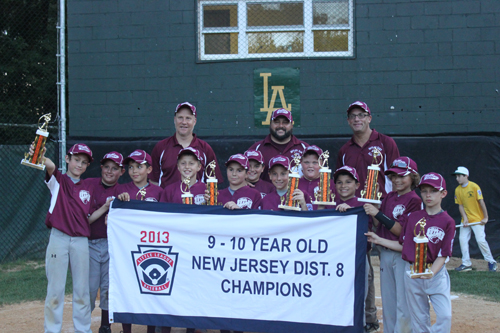 Photo courtesy of Dave Walsh The Nutley East 10-year-old All-Stars proudly display their trophies after winning the recent District 8 championship. From left are Joe Pezzino, Nick Polewka, Chase Nicolette, Justin Edert, John Coppola, Jake Walsh, Scott Christman, Billy Searle, Joe Senatore, Spencer Ojeda, Max Malanga. In the back from left are coaches Billy Edert, Dave Walsh and Dave Christman. Nick Palangio was missing from the picture