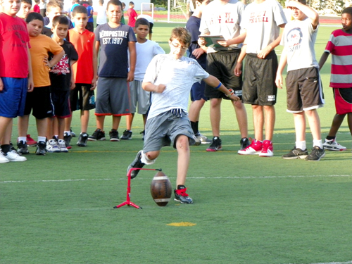 Photo by Jim Hague Jacob Platero shows off his kicking skills during the Kearny football camp.