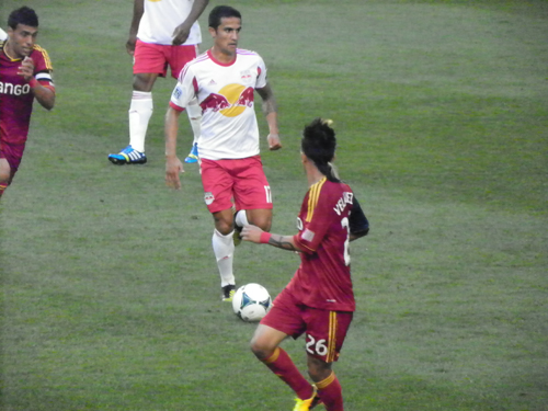 Photo by Jim Hague Red Bulls midfi elder Tim Cahill (17) moves through Real Salt Lake defenders Ned Grabavoy (l.) and Sebastian Velasquez (r.) during Saturday night's 4-3 wild win for the Red Bulls.