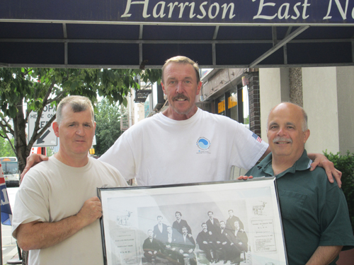 "Trustee Larry Park (l.), 20-year lodge member John Lednovich (c .) and Exalted Ruler Larry Bennett display an archival photo of the ""Jolly Corks,"" a group of unemployed New Yo rk actors who were the progenitors for today's Elks."