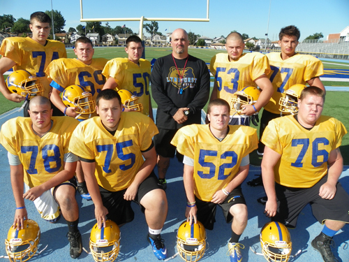 Photo by Jim Hague The Lyndhurst football team opens Sept. 14 at Wood-Ridge. Front row, from l., are Jonathan Carbone, Brian Perez, Fred Rivers and Connor Clifford. Back from l., are Albert Saiti, Nick Antiorio, P.J. Urgola, head coach Joe Castagnetti, Denniz Akar and Tony Urgola.