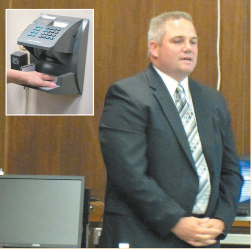 "Photos by Ron Leir Kearny BOE employees could end up ""clocking in"" using electronic palm readers like the one (inset) at Town Hall furnished by ADP, whose sales representative Vincent Kelly pitched his product to the BOE."