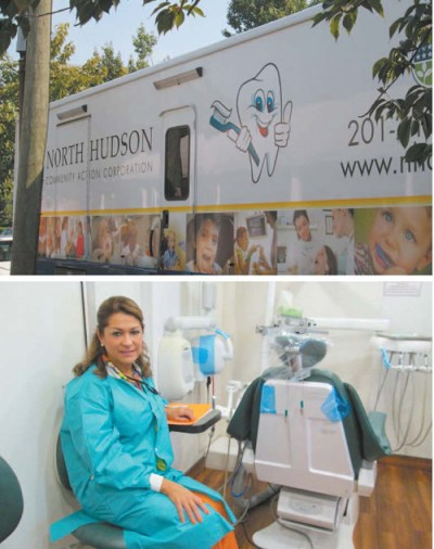 "Photos by Ron Leir North Hudson CAC mobile dental van (top) came to Kearny last week. Inside, Dr. Mercedes Rabeiro-Wert, the dentist assigned to the unit, sits in her ""office."""