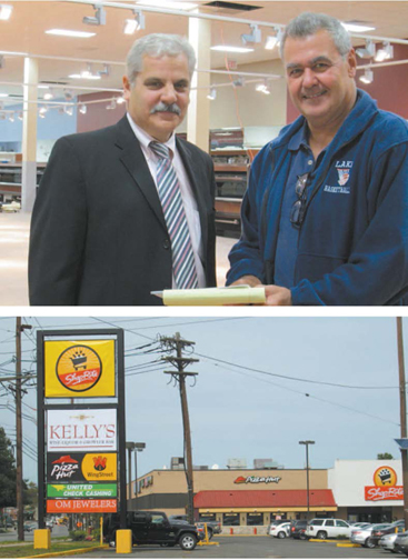 Photos by Ron Leir Co-owner Vincent LoCurcio (l.) and construction manager Frank Salas prepare for opening of new Belleville ShopRite, as evidenced by new signage.