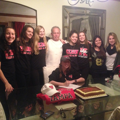 Photo courtesy the Sroczynski family The entire Kearny girls' track team with coach Jim Cifelli (center) celebrates Aislinn Sroczynski signing a national letter of intent to attend the University of Tampa.