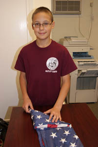 Photos by Karen Zautyk Boy Scout Kirill Pavlov, 13, of Nutley respectfully folding 'retired' American flag.