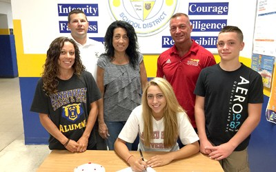 Photo by Jim Hague Lyndhurst's Jessica Failace (seated) signed her national letter of intent to attend Sacred Heart University in the fall. With Failace, standing from l., are Lyndhurst soccer and girls' track coach Kim Hykey, athletic director Jeff Radigan, Dawn Failace (Jessica's mother), Mike Failace (Jessica's father) and Michael Failace (Jessica's brother).
